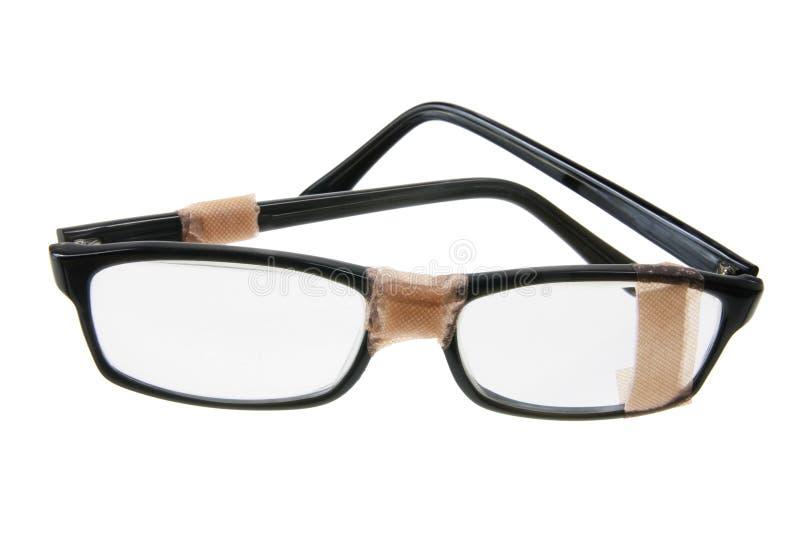 Eyeglasses quebrados imagens de stock