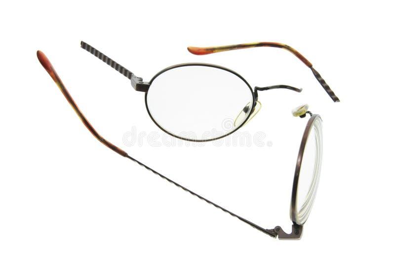 Eyeglasses quebrados fotografia de stock royalty free