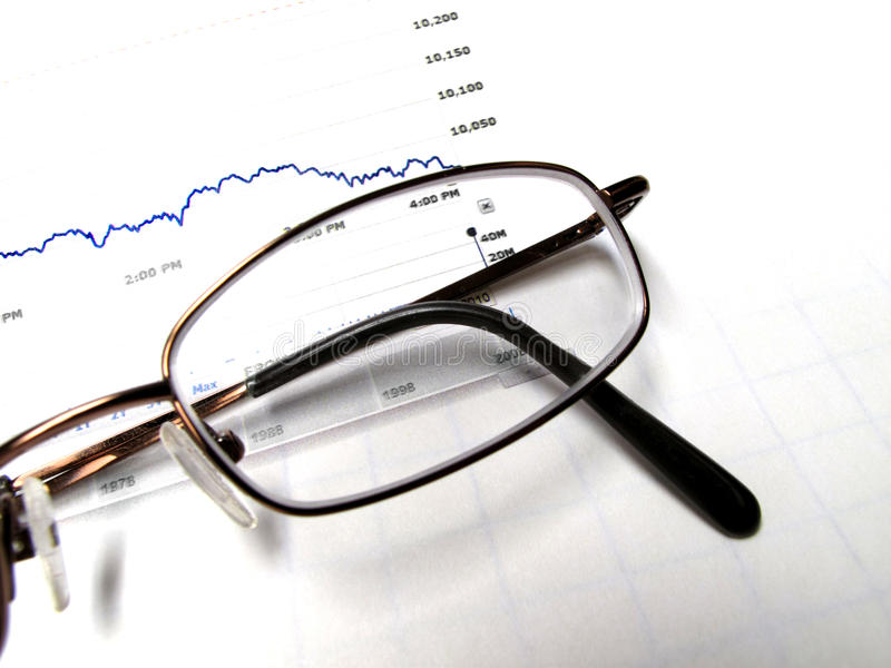 Eyeglasses and Stock Chart. Closeup of Eyeglasses with stock chart Background stock images