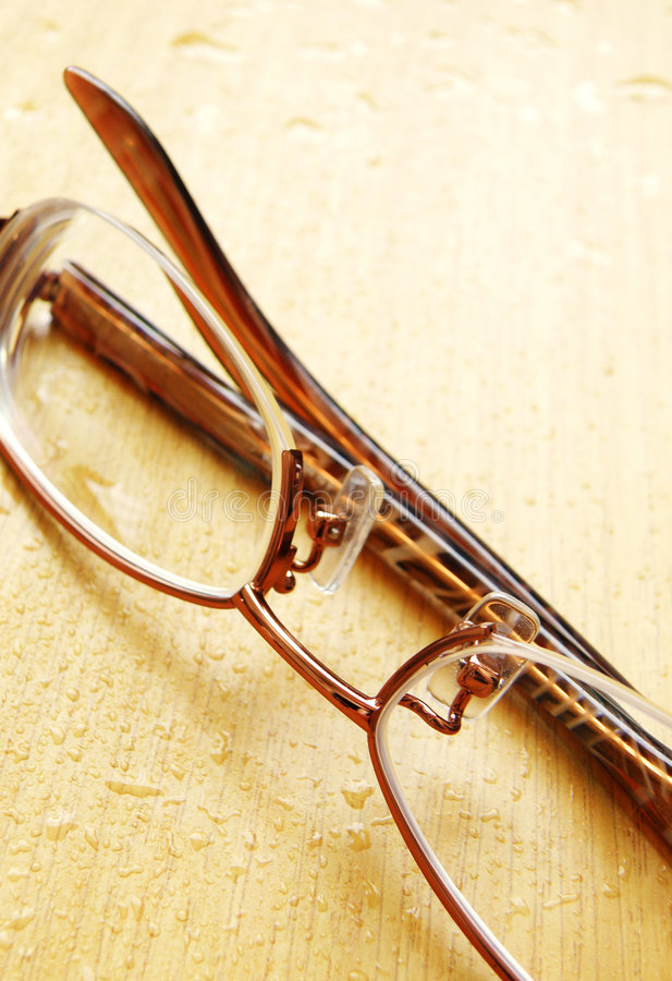 Download Eyeglasses On Wet Wood Table Stock Image - Image: 7201651