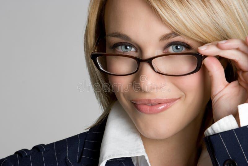 Eyeglasses Woman. Blond business woman wearing eyeglasses royalty free stock photos