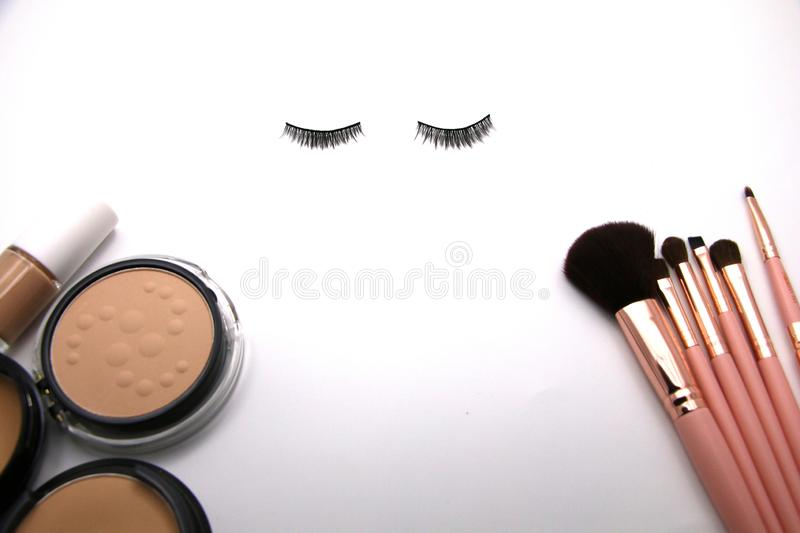 Eyelash concept Makeup foundation with blush set and on white background. Copyspace for text. Eyelash concept Makeup foundation with blush set and on white royalty free stock photos