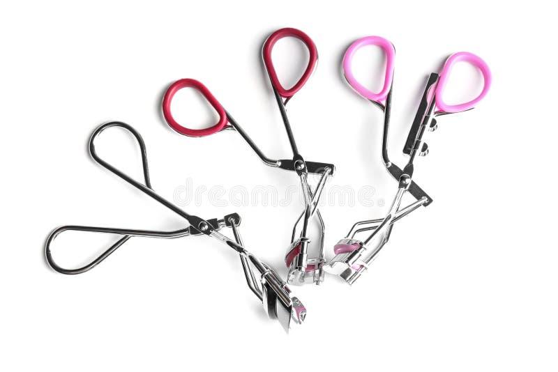 Eyelash curlers on background. Eyelash curlers on white background stock photos