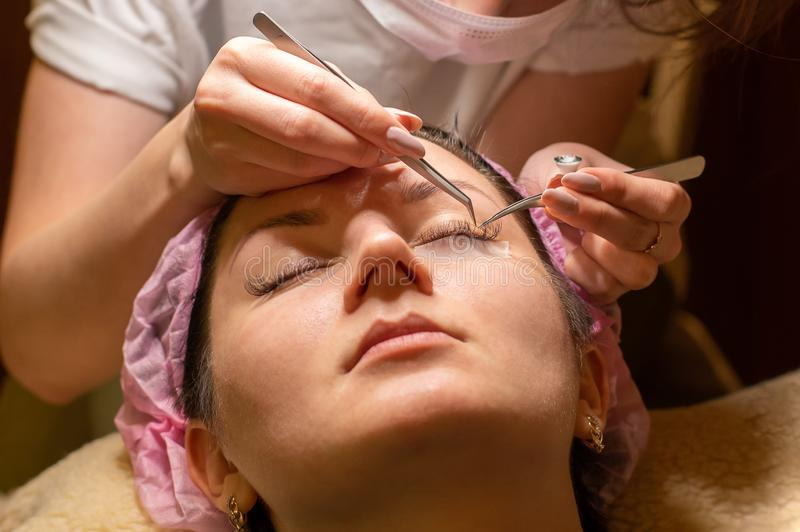 Eyelash extension procedure. Female eye with long eyelashes. Eyelashes, close-up, selective focus stock photo
