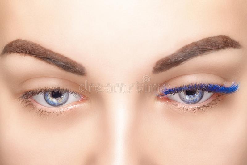 Eyelash Extension Procedure. Woman Eye with Long Blue Eyelashes. Ombre effect. Close up, selective focus. Eyelash Extension Procedure. Woman Eye with Long stock image