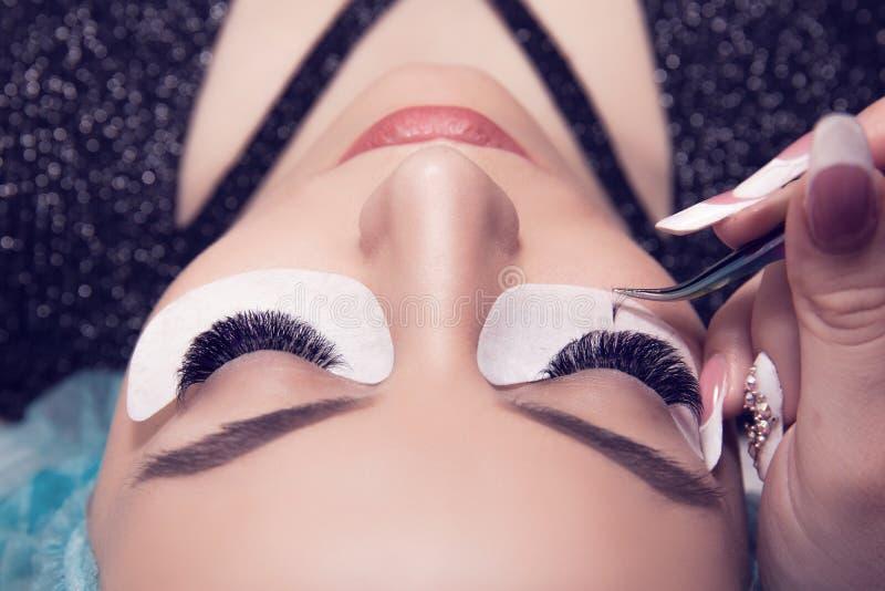 Woman eye with long and thick eyelashes having eyelash extension stock photos