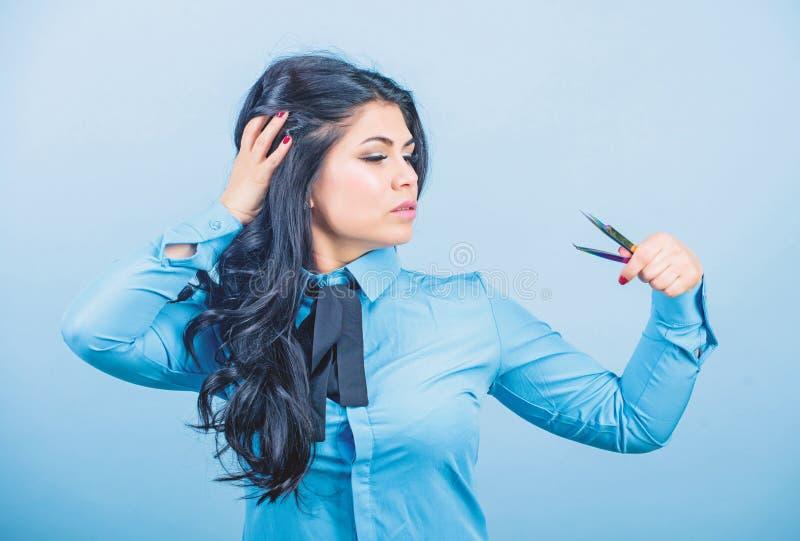 Eyelash extension tweezer. Professional makeup artist. Cosmetic tweezer tool. Beauty shop concept. Girl makeup face hold stock images