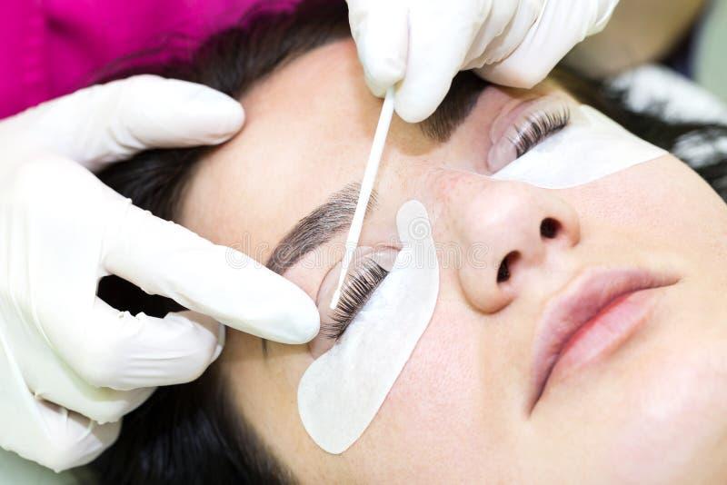 Eyelash extensions, eyelashes lamination. Woman on the procedure for eyelash extensions, eyelashes lamination royalty free stock image