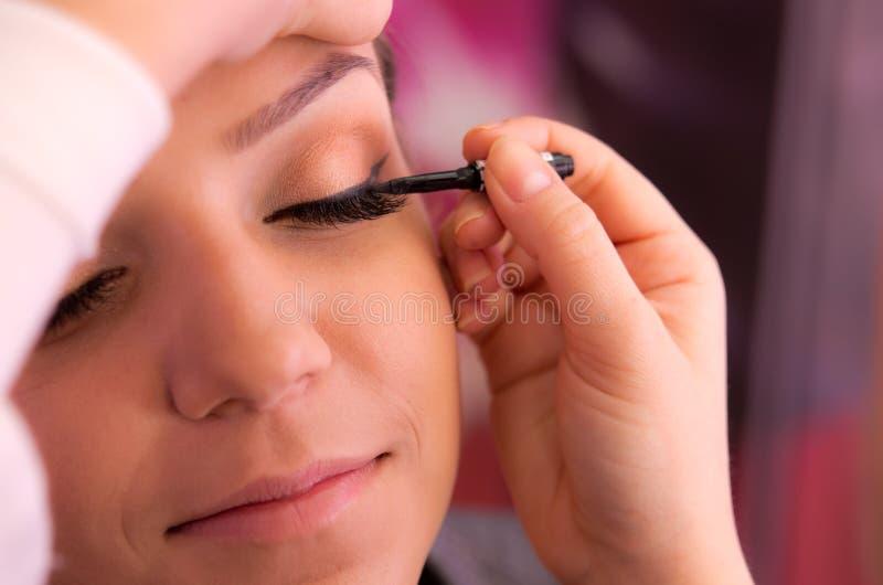 Eyelid makeup. Woman having makeup applied to eye