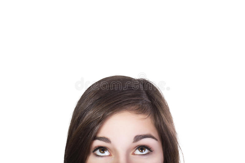 Eyes of brunette woman looking up dumbfounded royalty free stock photos