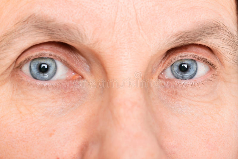 Eyes with Contact Lenses. Closeup of adult woman eyes wearing soft contact lenses royalty free stock images