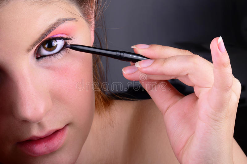 Download Eyes Makeup stock image. Image of beauty, lashes, hand - 21157201