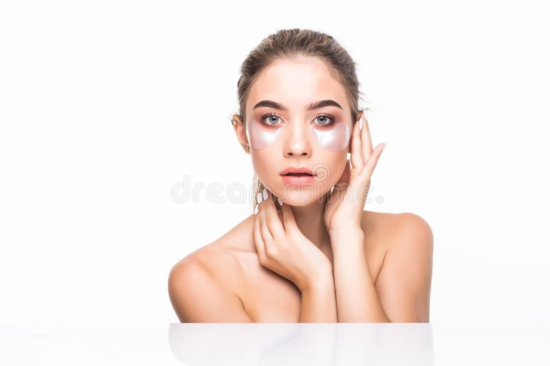 Eyes patches woman cosmetic beauty healthy skin portrait isolated on white background. Skin care concept. royalty free stock photo