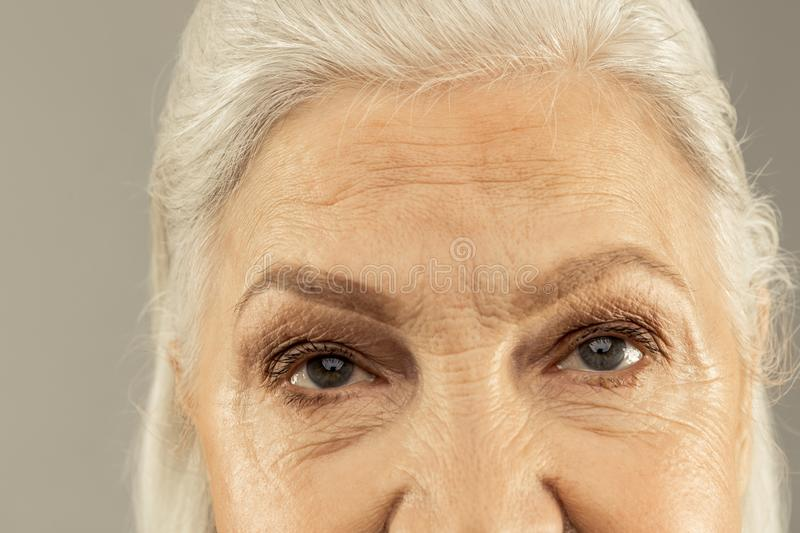 Eyes of a pleasant nice elderly woman royalty free stock image