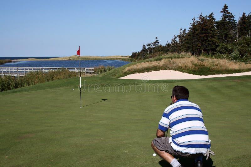 eyes putt игрока в гольф стоковая фотография rf