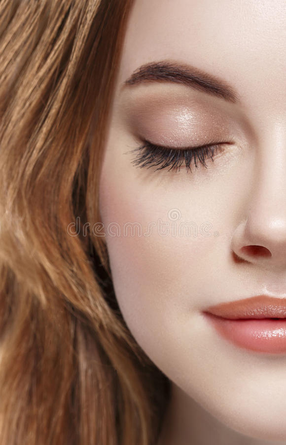 Eyes woman closed eyebrow eyes lashes half-face lips nose stock photo
