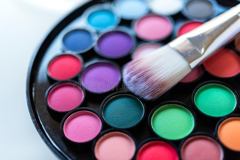 Eyeshadow Colorful pastel cosmetics and make up plate with brush, Copy space. royalty free stock photo