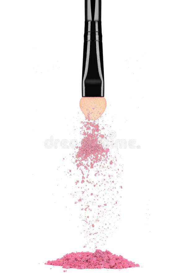 Eyeshadow fall down from makeup brush isolated on white. Background stock images
