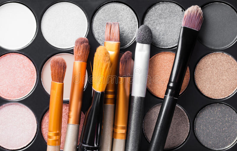 Eyeshadow Palette and brushes. Set of decorative cosmetics, Eyeshadow Palette and brushes royalty free stock photos