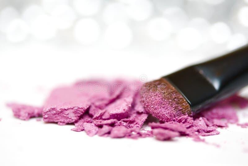 Eyeshadow powder and brush royalty free stock photo