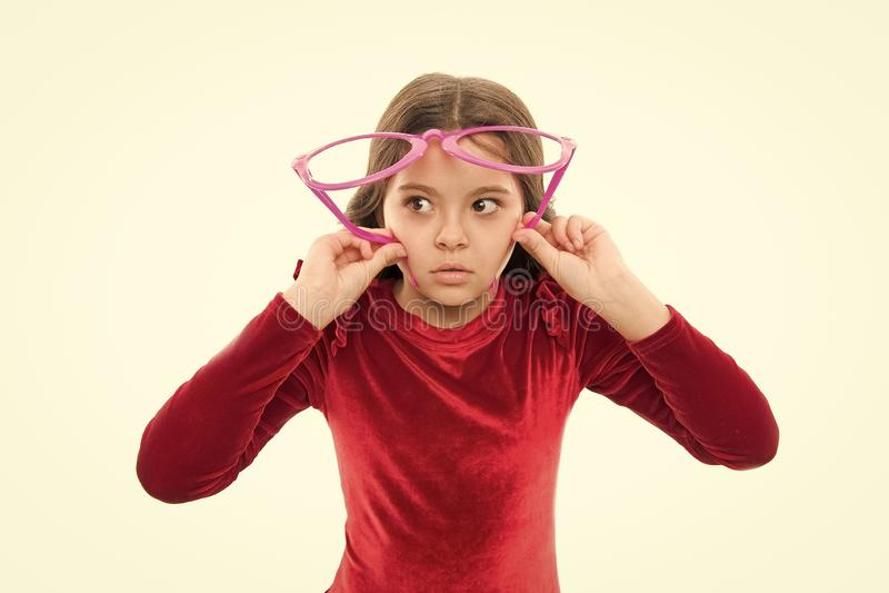 Eyesight and eye health. Improve eyesight. Girl kid wear big eyeglasses isolated white background. Optics and eyesight. Treatment. Effective exercise eyes stock image