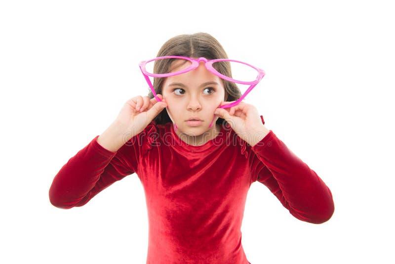 Eyesight and eye health. Improve eyesight. Girl kid wear big eyeglasses isolated white background. Optics and eyesight. Treatment. Effective exercise eyes royalty free stock photos