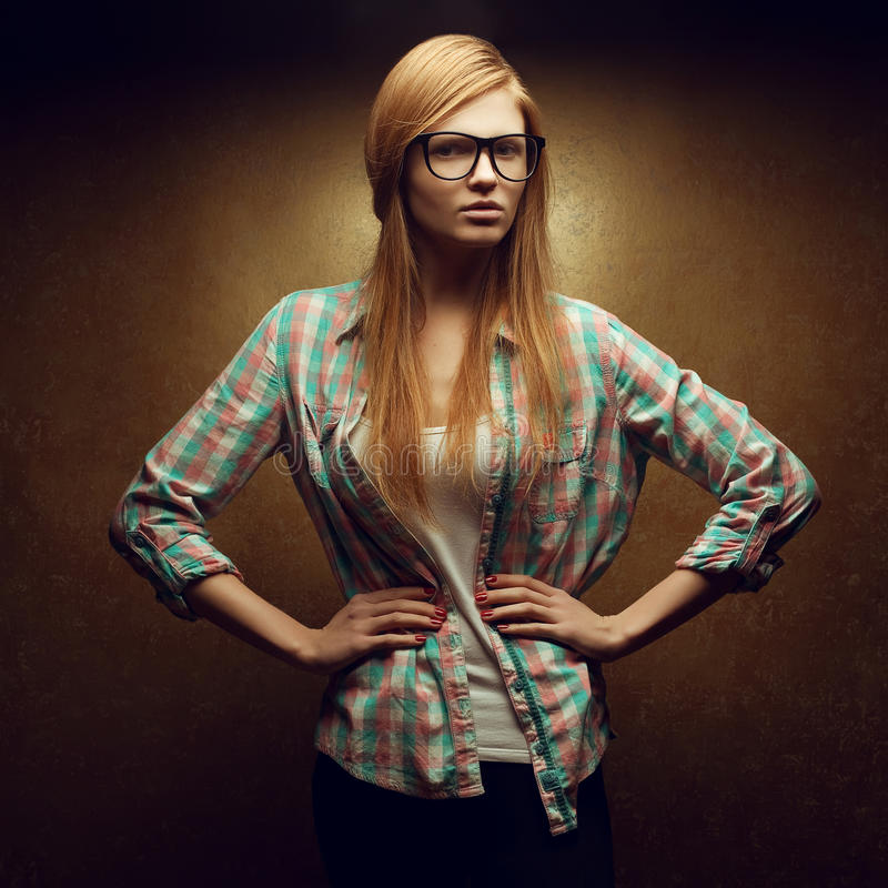Eyewear concept. Portrait of beautiful red-haired girl wearing glasses stock photo