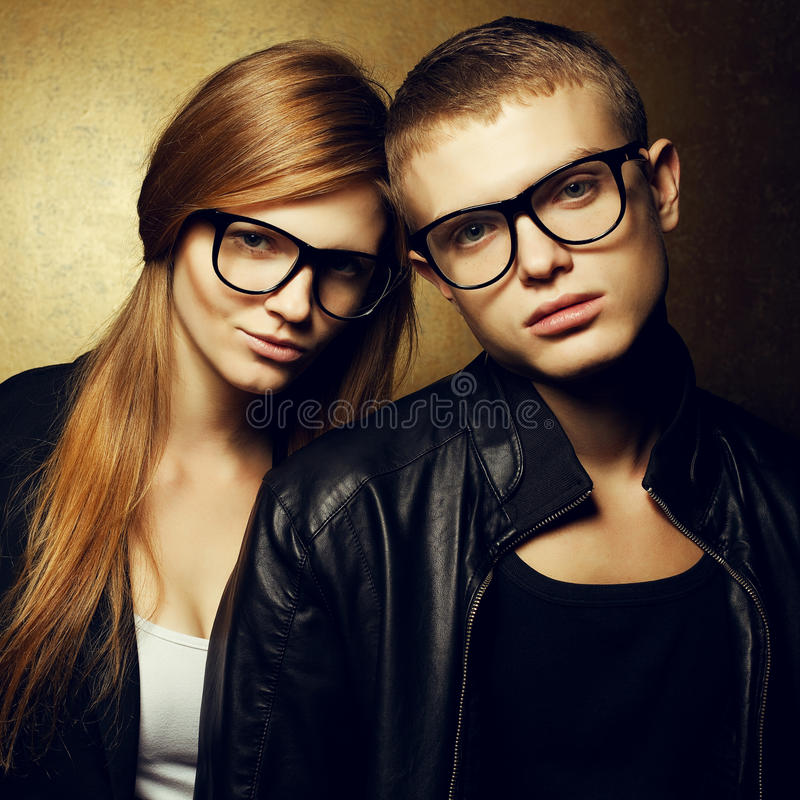 Eyewear concept. Portrait of red-haired fashion twins in black clothes royalty free stock photography