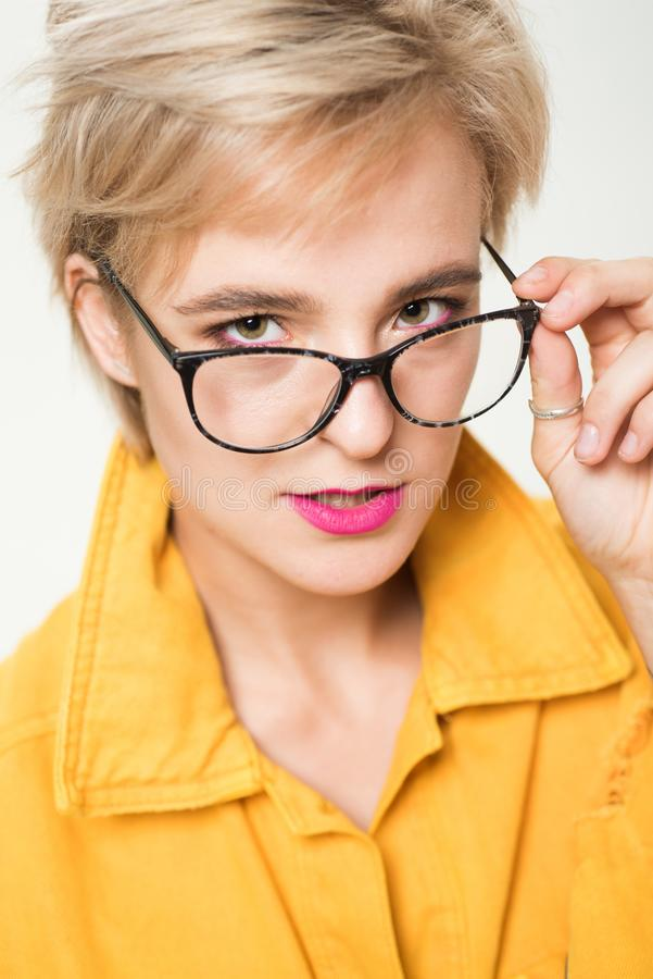 Eyewear fashion. Add smart accessory. Stylish girl with eyeglasses. Eyesight and eye health. Good vision. High quality. Lens. Fashionable eyeglasses. Woman royalty free stock images