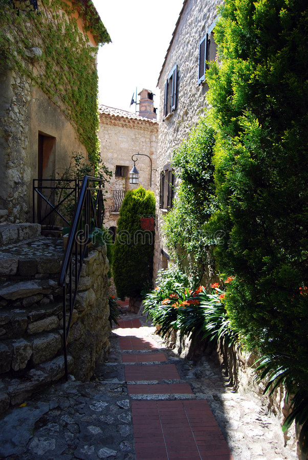 Eze Village. An alley in Eze Village, a little ancient village in France in Alpes Maritimes, near the principality of Monaco stock photography