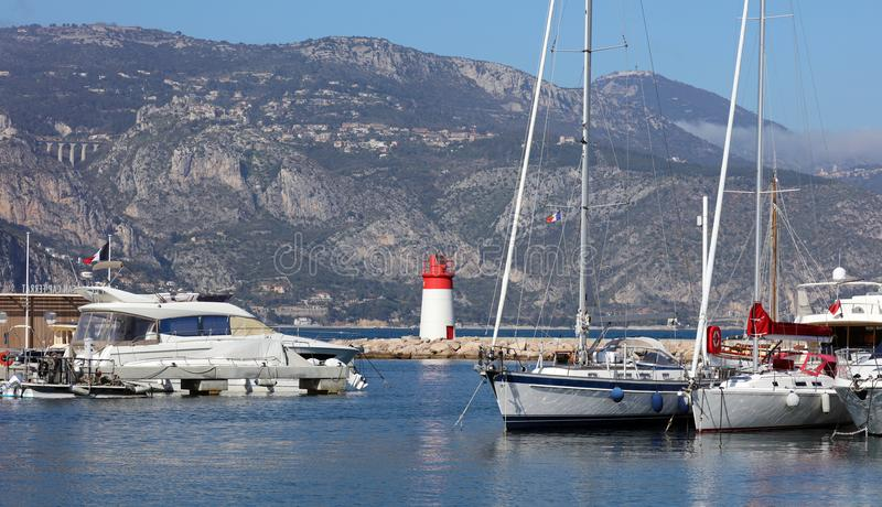 Eze village French riviera, Côte d`Azur, mediterranean coast, Eze, Saint-Tropez, Cannes and Monaco. Blue water and luxury yachts. Eze village Nice French royalty free stock image