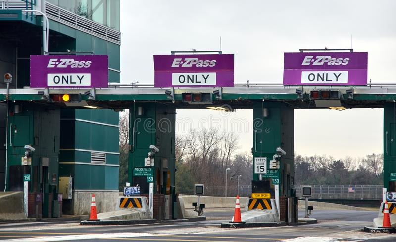 EZPass signs and terminal. NEW YORK, USA - DECEMBER 14, 2018: EZPass signs and terminal. E ZPass is electronic toll collection system used on tolled roads stock photo