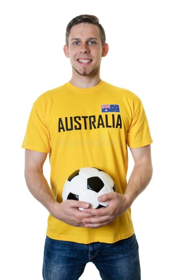 Fã de futebol australiano de riso com bola imagens de stock royalty free