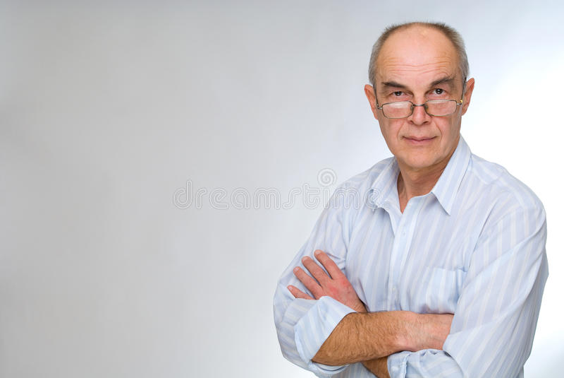 Fälliger Geschäftsmann in den Gläsern lizenzfreies stockfoto