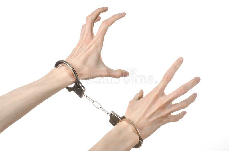 Fängelse och beslagit ämne: manhänder med handbojor som isoleras på arkivfoton