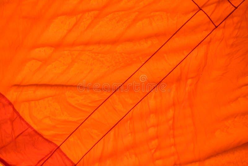 Färben Sie Gewebe orange Beschaffenheit verwendet als Hintergrund stockfotos