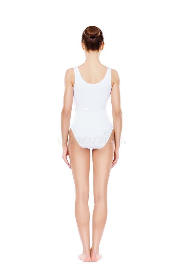 Färdig och sportig flicka i den vita underkläderna arkivfoto
