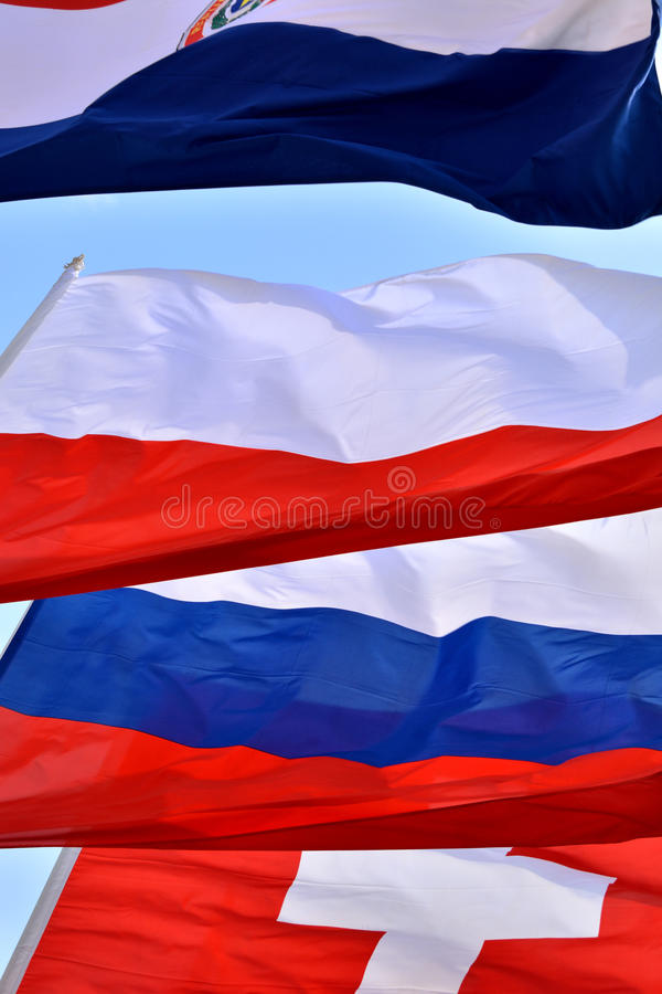 Färg och sammansättning av olika nationsflaggor arkivbilder