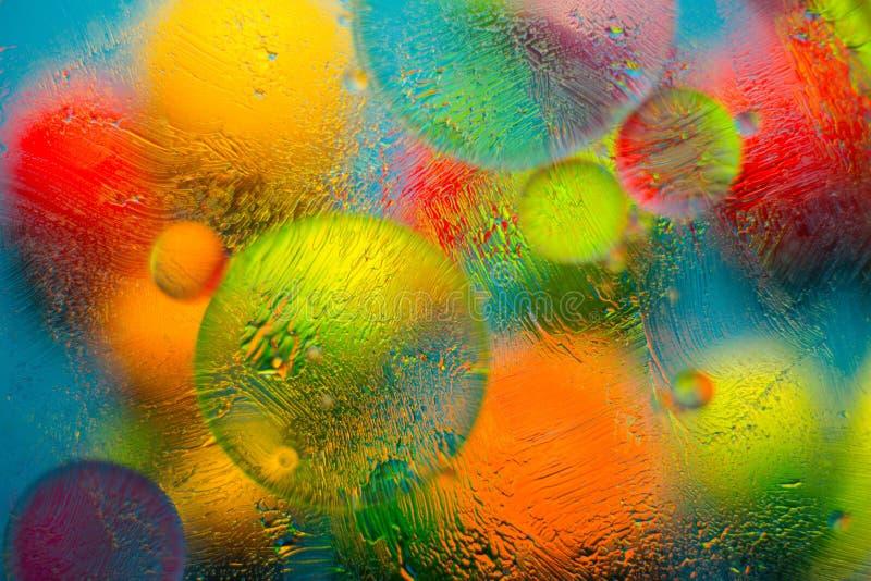 Färgad bakgrund, när blanda vatten, olja och salvan arkivfoton