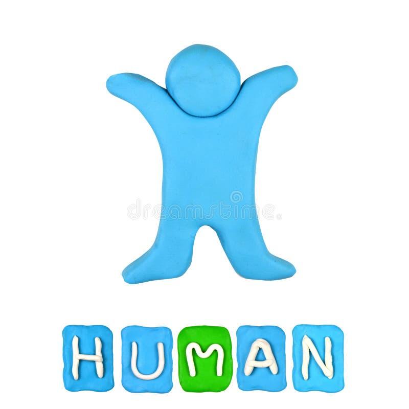 Färgbarns mänskliga plasticine royaltyfri foto