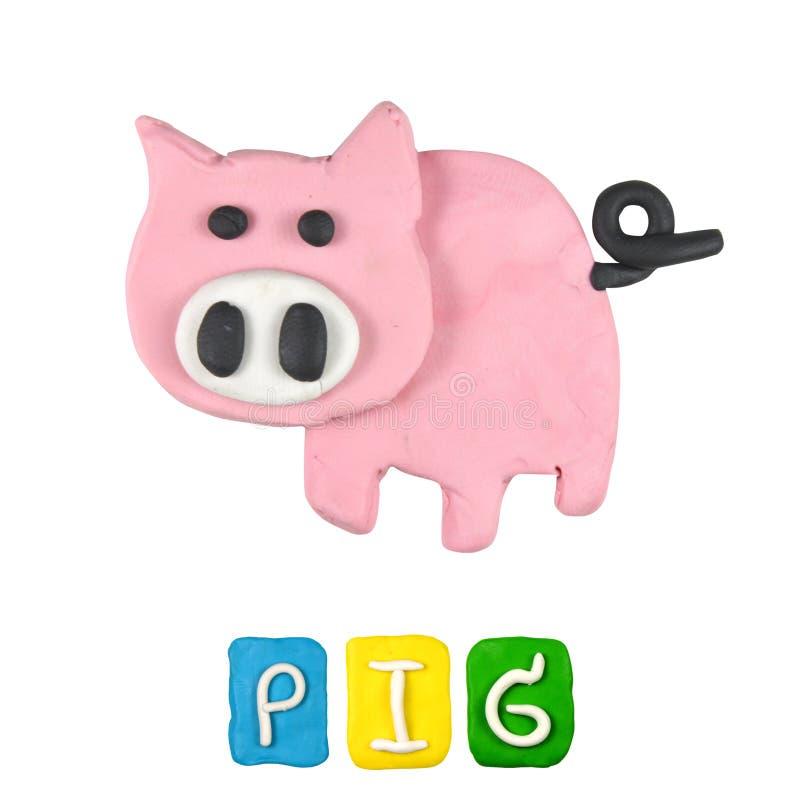 Färgbarns plasticine för svin arkivbild