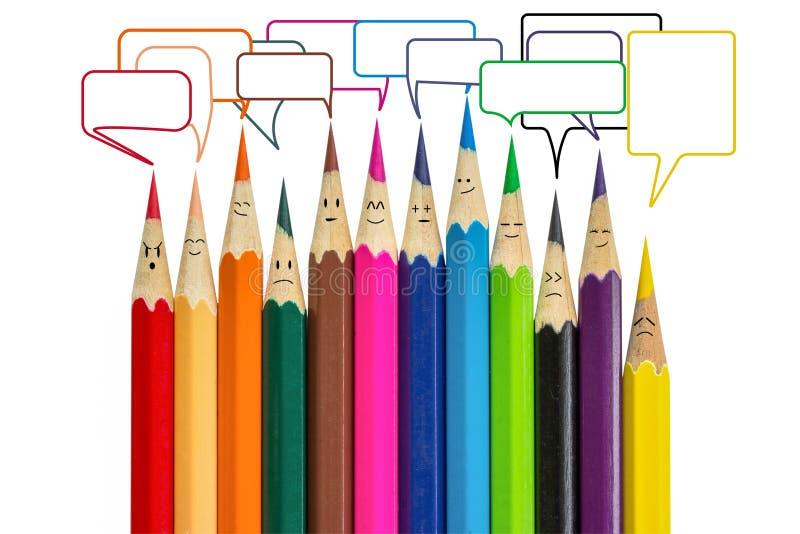 FärgblyertspennaandFace har många sinnesrörelser och textasken royaltyfri foto
