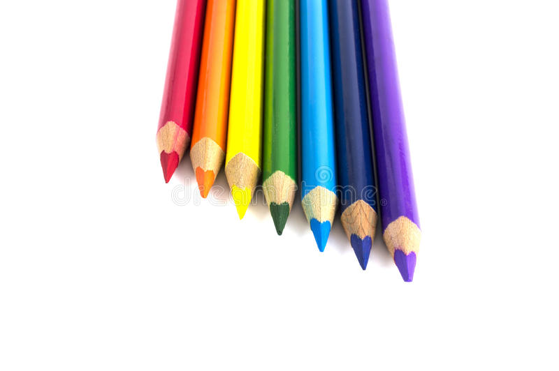 Färgblyertspennor som isoleras över vit arkivfoto