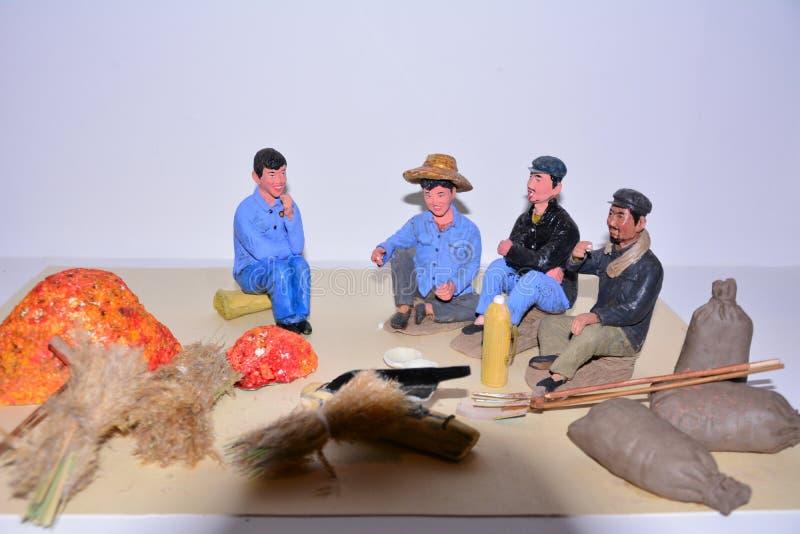 Färgen av lerakinesbönderna royaltyfria foton