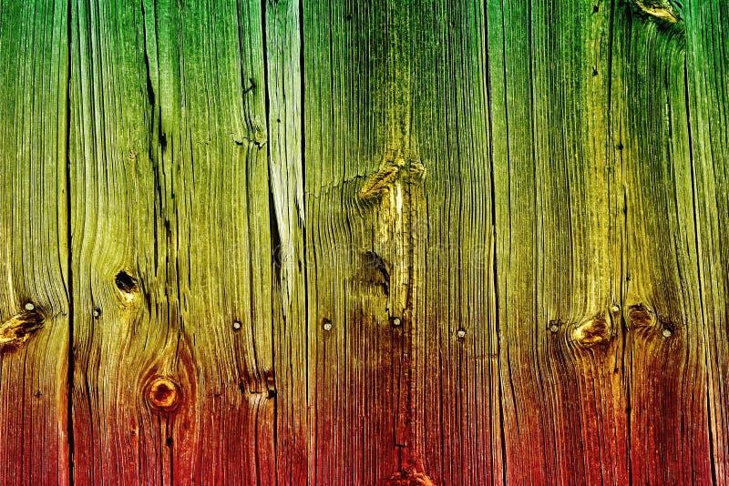 Färger av reggaen på den wood bakgrunden royaltyfri foto