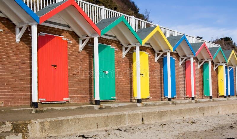 färgglad kojaswanage för strand royaltyfria foton