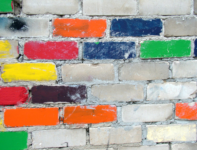 färgglad vägg för tegelstenar arkivfoton