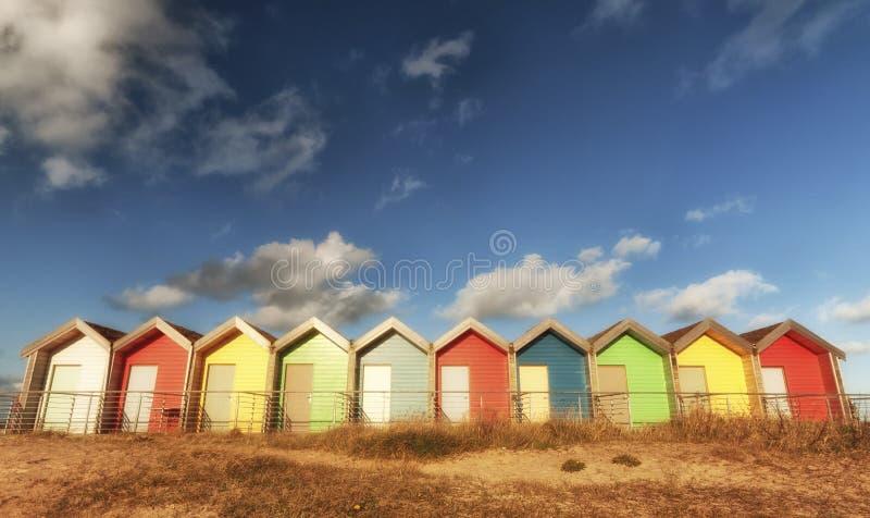 Färgglada strandkojor royaltyfri bild