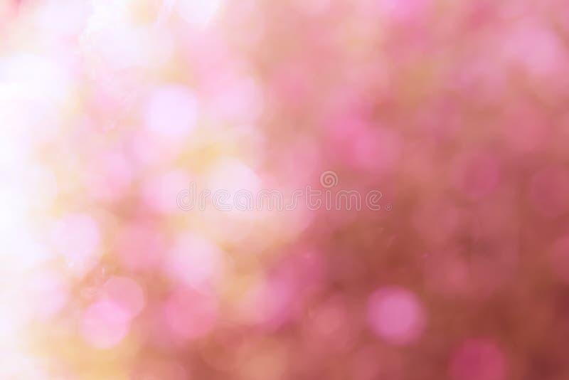 Färgglat av suddiga söta rosa färger för bokehljus arkivfoton
