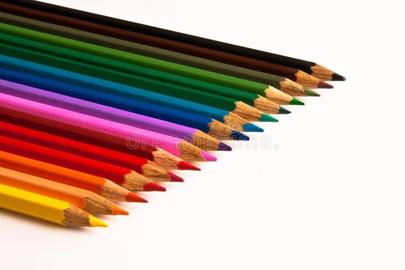 färgläggningen pencils rad fotografering för bildbyråer